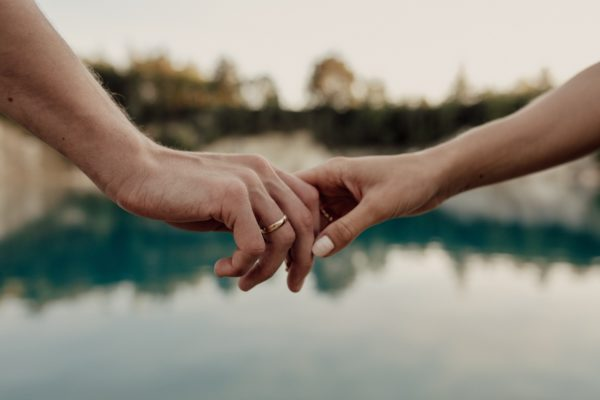 Love couple. Holding hands